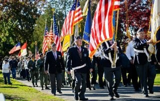 ROTC Group Marching with American Flags